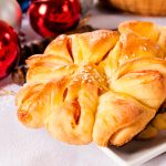 Homemade pastry stuffed with ham and with New Year decoration in the background